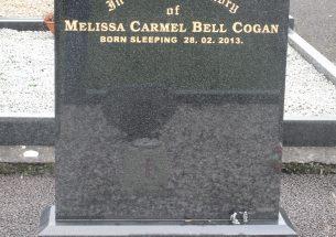 Regal black headstone