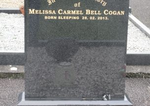Regal black headstone